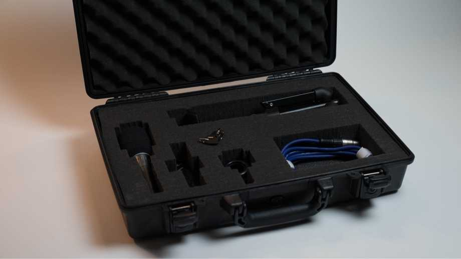 open pelican case filled with audio gear